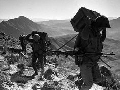 Soviet troops carrying supplies through the mountains of Afghanistan, pin by Paolo Marzioli
