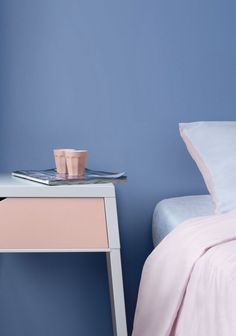 Pantone's ColorS 2016:  Serenity blue bedroom walls with Rose Quartz accessories