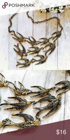 "NEW Antique Bronze Swallow Statement Necklace Brand new antique bronze metal statement collar necklace featuring nine elegant swallows.  Pendant Size: 6""W x 5""L Chain Length: 20"" Jewelry Necklaces"
