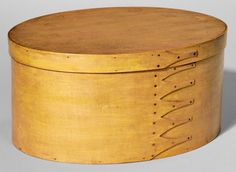 Skinner's Shaker Auction 2898M. June 4, 2016. Lot: 209.  Estimate: $1,200-1,500.  Realized: $3,690.  Description:  Shaker Pine and Maple Oval Box, New Lebanon, New York, pine top and bottom with bent maple sides joined by six fingers fastened by copper tacks, refinished with traces of bittersweet-colored paint, ht. 7 3/8, wd. 11, lg. 15 in.