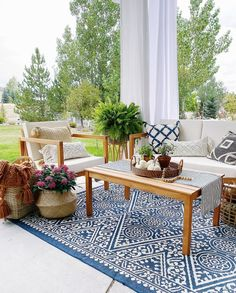 How I'm decorating the porch and patio for fall using blue and white - jane at home
