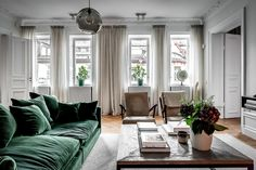 Green Velvet Sofa And Large Library Apartment In Stockholm - Green Velvet Sofa Is The Main Feature And Color Accent In This Elegant Two Bedroom Apartment In Stockholm Thanks To It Monochrome Gray White Home Has Acquired Its Individuality And Character As Living Room Green, Boho Living Room, Living Room Sofa, Living Room Interior, Home Interior Design, Home And Living, Living Room Decor, Green Velvet Sofa, Green Sofa