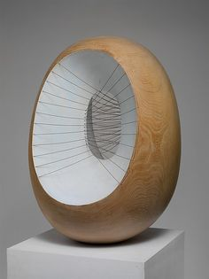 Artist:  Barbara Hepworth  Title: Oval Form with Strings and Color Medium:  Elmwood and painted Elmwood with cotton strings  Dimensions:  33 7/16 x 22 7/16 x 21 5/8 in. Date:  1966