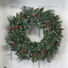 Adorn your front door with beautiful holiday spirit with the Classic Pre-lit Wreath. Christmas Wreaths, Christmas Decorations, Christmas Tree, Christmas 2014, Pre Lit Wreath, Red Berries, Luxury Home Decor, Shape Design, Natural