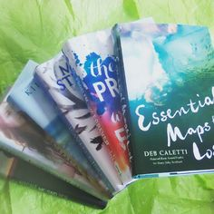 Soooo this is my attempt at a #bookspiral. I'm not very good at it. But at least I tried for #LILBookishMay day 11! Also I'm so excited to have the beautiful finished copy of ESSENTIAL MAPS FOR THE LOST by @debcaletti! Thank you @simonteen & @irish_banana!  by jessbooklover