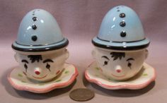 Now these clowns aren't scary at all.  Vintage Clown Egg Cups With Hats That Are Pepper Shakers.