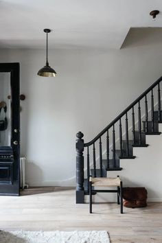 This particular craftsman staircase is truly a noteworthy design principle. Black Stair Railing, Black Staircase, Staircase Railings, Wood Stairs, Staircase Design, Bannister, Wrought Iron Stair Railing, Staircase With Landing, Modern Stairs Design