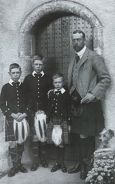 future King Edward VIII, future King George (Queen Elizabeth's father), with their father King.........jackets are sharp, with a straight skirt....or a kilt