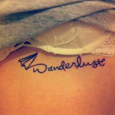 """""""Wanderlust"""" tattooed under her left breast."""