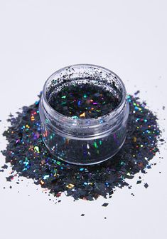 The Gypsy Shrine Black Diamond Face Glitter cuz you like to keep it dark. This holographic black glitter is safe for your face, body, N' hair and has different sized pieces to give you a dynamic look.