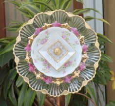 Pink, Gold And deviled eggs....these 3 words combine to make an amazing ooak piece of garden ART. If you want to add some unusual beauty to your