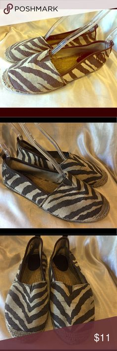 Michael  Kors zebra striped espadrilles size 11 Well worn Michael Kors  zebra striped espadrilles size 11 these shoes also has hint of cigarette smoke odor Price reflects MICHAEL Michael Kors Shoes Espadrilles
