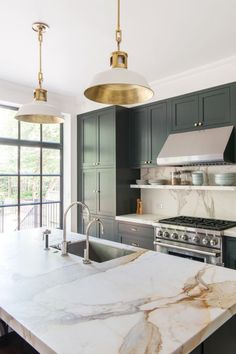 Kitchen Decor kitchen-with-marble-countertop-pendant-lights-green-blue-cabinets-elizabeth-roberts - When a young family—a lawyer and dance professor and their two young sons—purchased a Brooklyn townhouse, the building had been subdivided into four apartm Classic Kitchen, Timeless Kitchen, Green Cabinets, Dark Cabinets, Upper Cabinets, Shaker Cabinets, Wood Cabinets, Wall Cupboards, Pantry Cabinets