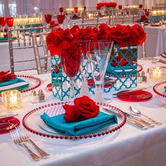 Red and Teal tablescape for weddings red roses red beaded charger plates