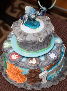 SKYLANDERS GIANTS  cake with spinning and glowing upper tier :)