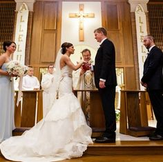 Our bride, Megan, wore an incredible tiered gown from Tara Keely!  Her veil is from Sara Gabriel!