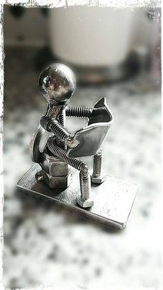 Nuts and bolts welded art.