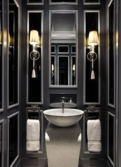Mirrored walls & sconces