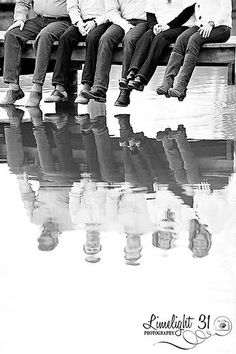 creative family photo--reflection in the water - black and white family photography