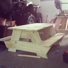 A picnic table built using what looks like 2 x 10's and 2 x 12's