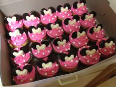 Minnie Mouse cupcakes made for a little girl's second birthday. Chocolate and vanilla cake, butter cream icing colored pink, edible pearls, mini-Oreo ears, and a white chocolate (molded) bow! The cutest!