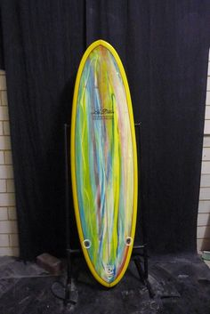 Len Dibbens This great looking surfboard with the multi acid wash deck & yellow tinded rails & bottom & a red pin gives this 6 ft 1''x 20 1/2'' x 2 1/2'' round tail surf machine a distinct look The bo...