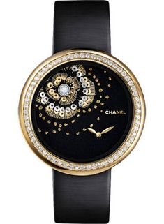 One of three new Chanel Mademoiselle Privé Camellia Brodé Lesage watches, hand embroidered with yellow gold and green silk thread, gold sequins and natural pearls. Stylish Watches, Luxury Watches, Cool Watches, Wrist Watches, Chanel Jewelry, Luxury Jewelry, Chanel Mademoiselle, Datejust Rolex, Chanel Watch