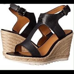 """Shop Women's Coach Black size 10 Espadrilles at a discounted price at Poshmark. Description: Celebrate your trending style with the modern day leather espadrille with sling back strap with buckle closure. T-strap design. Signature logo hardware detail. Jute-wrapped midsole and wedge. Approx heel 3 1/2"""", platform 1"""".. Sold by tnb614. Fast delivery, full service customer support."""