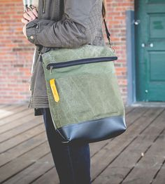 Canvas & Leather Messenger Bag | This canvas & leather messenger bag features a foldover top an... | Messenger Bags