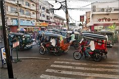 One of two popular and cheap transportation are tricycle