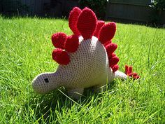 """Cuddly stegosaurus pattern, approx 12"""" long. Requires polyester stuffing, and two colours of dk wool. A bit unsure of the total yardage requirements, but probably 50g of the main colour."""