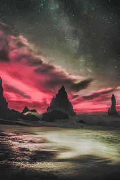 Ice peaks look like magical castles under an intense magenta sky. Taken in Iceland.