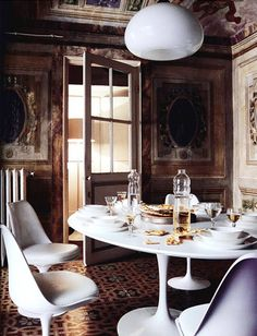 i wish they would have used a chandelier here but who really cares! great table & chairs in a fantastic room!