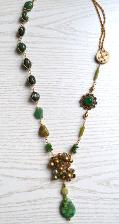 vintage brooch and earclip, vintage stone necklace, stones and a vintage charm for a one-of-a-kind necklace