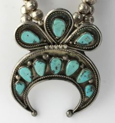 Vintage Native American Sterling Silver Stunning Squash Blossom Necklace with delicate turquoise stones and matching earrings NA1487