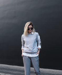 grey outfit: sweatshirt + suit pants.