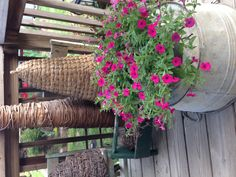Good idea..instead of planting flowers in the galvanized tub..set potted flowers on top