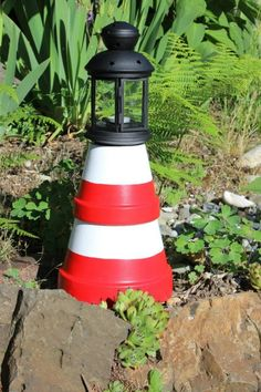 I found the perfect lantern at Ikea to use for this clay pot lighthouse. These cute yard decorations are easy to make!