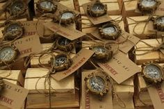 Indiana Jones Party.  Treat boxes.  Jute.  Dollar Store compasses, wooden boxes from Michaels decorated with stamps.  Inside, gold coins, a sack of gold nugget bubblegum and a skull whistle.  Add in a rolled up thank you note.