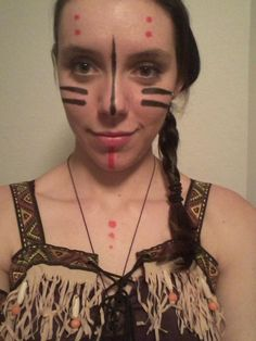 My Indian Tribal face paint from Halloween this year! I did circles and arrows on my arms, legs, and back, too! :)
