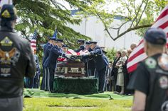 Joint Base Lewis-McChord Honor Guard members fold the flag that was draped over the casket of Capt. Douglas D. Ferguson, May 2, 2014, at Mountain View Funeral Home in Lakewood, Wash. Ferguson was killed in the Vietnam War and was finally laid to rest at home after being missing for more than 44 years. (U.S. Air Force photo/Tech. Sgt. Sean Tobin)