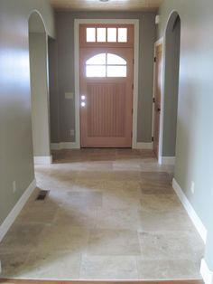 Travertine floors... in entryway, kitchen, dining room?