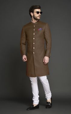 This Tan Brown Achkan goes well with all skin tones. Tailored & designed for an ambitious modern man, this Achkan features interesting tailoring details over bling and will make you look every bit elegant and sophisticated. Sherwani For Men Wedding, Wedding Dresses Men Indian, Wedding Dress Men, Kurta Men, Mens Sherwani, Blazer Outfits Men, Stylish Mens Outfits, Green Suit Men, Mens Ethnic Wear