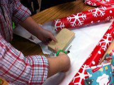 Wrap the blocks and put them under the Christmas tree! Fine motor, scissor skills