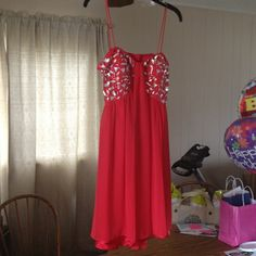 Morgan & Co.  Homecoming /Prom Party Dress Red party dress w/see through silky polyester over satin, padded bra w/embellishments in front top & back straps, open back w/ one strap across that clasps together & a zipper in back Morgan & Co. Dresses