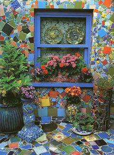 My house is blue and we have lots of brick work in our backyard.  It would be cool to do a colorful mosaic like this on the covered patio next to the pool.