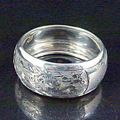 Sterling Silver Engraved Pattern Napkin Ring, 1900.