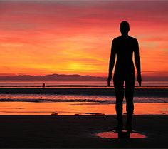 Sun setting over the Gormley statues....another place!