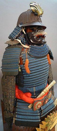 Over 20 pieces of Japanese Samurai armour w/ classic Edo period light weight wood storage case & framed rare Samurai Sashimono banner flag. Samurai armour includes manchira gorget from the Edo period, a true gusoku