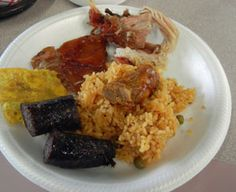 Sample of some traditional Puerto Rican MMM MMM good - arroz con gandules (rice & pigeon peas), morcilla (blood sausage), vianda (array of vegetables like plaintain, yucca) and Lechon (roasted pig). I crave these since my Papi taught me all that I know cooking Puerto Rican food. I miss him & miss these traditions.